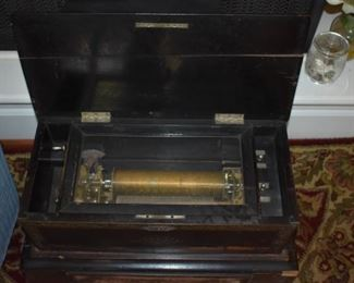 Antique Cylinder Music Box in Excellent Working Condition! The Cabinet contains a Pull Out Drawer which contains 2 more Cylinders!!! The sound is Absolutely Beautiful!!!
