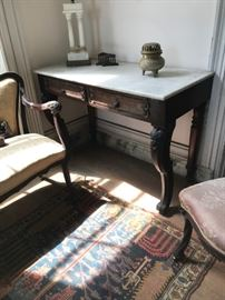 2nd quarter 19c Empire side table with a white marble top above two frieze drawers