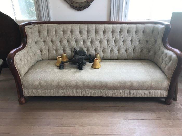 A 2nd quarter 19c Biedermeier tufted sofa matching previous chair