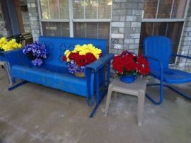 Vintage metal Glider and metal Chair. Outside Flower arrangements.