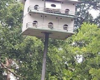 Large birdhouse on pole