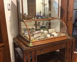 Antique General Store glass front display cabinet