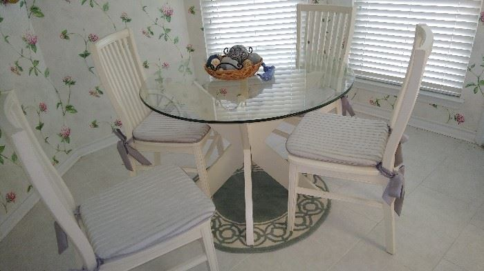 Pier One glass table with 4 chairs for the coastal look.