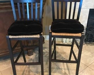 Pair of wooden bar chairs with woven rush seats