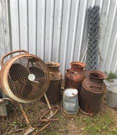 Vintage milk cans, fan, fencing