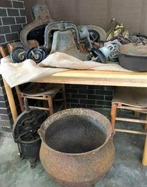 Vintage farm bell, vintage cauldron, vintage Enterprise Mfg sausage press, cast iron skillet, small table w/2 chairs, more