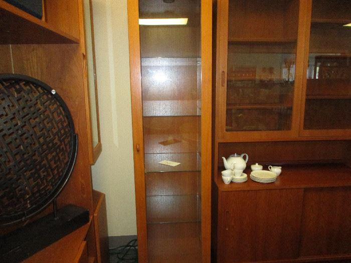 Narrow teak curio cabinet
