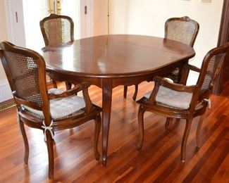 French Provincial dining table with 4 caned chairs