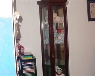 another curio full of dolls