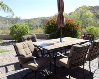 Patio table and chairs and umbrella for sale.