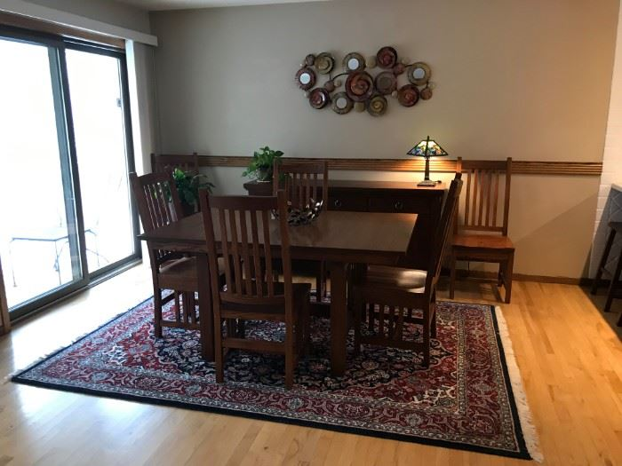 "Amish built solid oak Mission Style dining room table with 6 chairs.  The table is 60"" x 42"" and has 3 12"" leaves.  It is in very good condition."