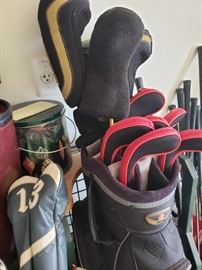 Lots of golf stuff- bags and clubs