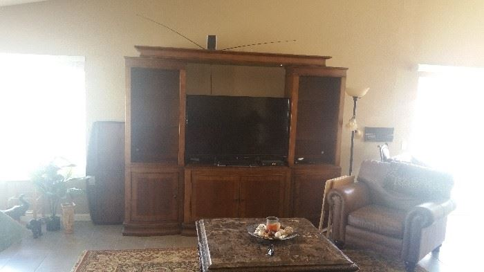 Beautiful Entertainment Center that can accommodate up to a 70 inch T.V.