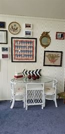 white wicker/glass top table, 2 chairs monogrammed, but can be easily changed.  Framed prints, needlework, bow ties in background