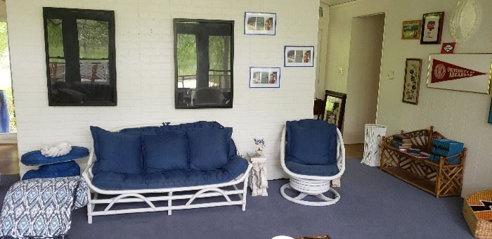 white wicker love seat, chair with blue cushions, shadow boxes