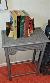 gray painted table, books, owl bookends