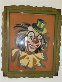 vintage frame with needlework of a happy clown