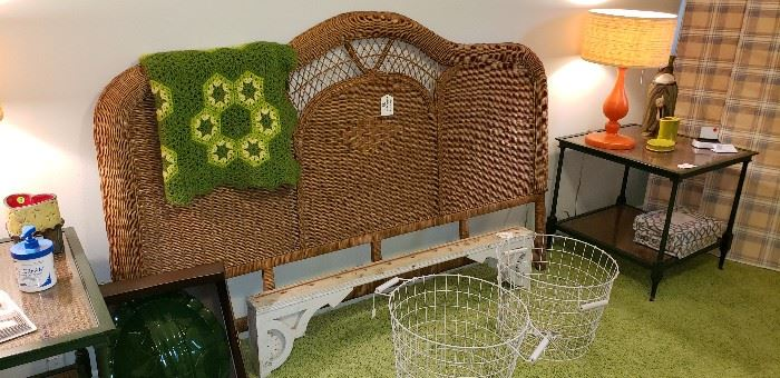 wicker king headboard, orange lamps