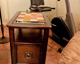 SIDE TABLE AND STATIONARY EXERCISE BIKE.