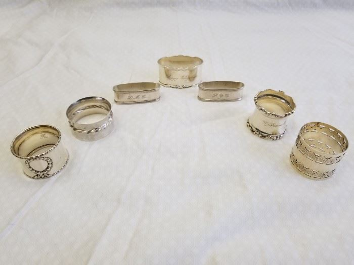 """Qty (7) Antique, polished pieces of Sterling Silver Hollowware/Napkin Rings. Gorham sterling wreath B1546, Towle sterling silver flute 102, two (2) RLB Rogers, Lunt & Bowlen sterling napkin rings 454, Shreve & Co. sterling napkin ring 5817, floral art nouveau ring marked """"Sterling 35"""", and Gorham sterling napkin ring B4182. All marked """"Sterling"""". See pictures for complete details and makers marks. See additional Sterling Silver items offered in Lot 4A."""