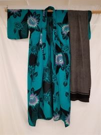 Beautifully colored, authentic silk, Japanese kimono with sash. This is another kimono, that according to the estate owner, was brought to the U.S. in 1953 by a WWII bride from Japan. See Lots 17 and 51B for additional kimonos that were brought over by the same owner.