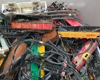 Trash can full of Model train track, cars, misc.