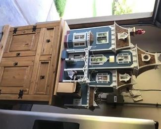 One of a kind Doll house!  mounted on pine cabinet and swivel base
