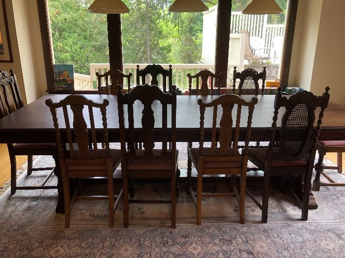"""Trestle style dining table and ten chairs.  Table is 120""""l x 48""""w x 31""""h  asking $800 selling chairs separately in sets of 2 and 4 depending on style"""