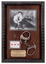 http://auctions.potterauctions.com/Houdini_Owned_Key_and_Signed_Houdini_Playing_Card_-LOT17325.aspx