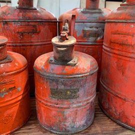 Vintage automotive gas cans.