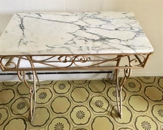 Carerra marble top table on wrought iron