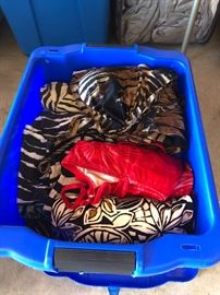 Just one of the tubs filled with swimsuits