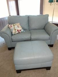 Like new light blue leather love seat with ottoman.