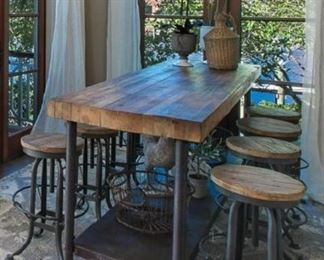 Antique industrial butcher block table, 8 adjustable bar stools, Pottery Barn area rug (new used for staging only)