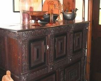 Antique Carved Cabinet with Decorative Items and Lamp