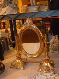 Candlesticks are Judaica, smuggled from Poland in WWII, made into a mirror with rosewood back
