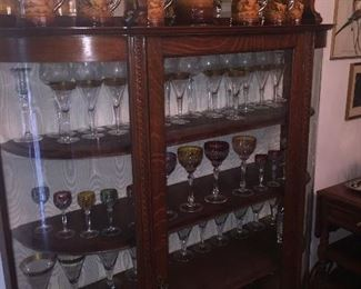 curved glass china cabinet with gorgeous early cut crystal and a 19th century German stein set