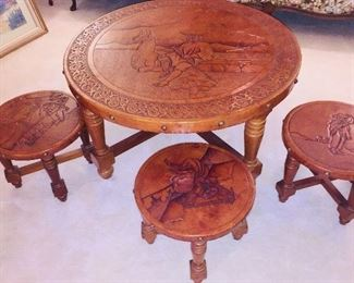 Peruvian leather tables with scenes from Peru carved into table tops--photo doesn't show their beauty