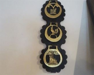 Tri of Horse Brasses on old Leather