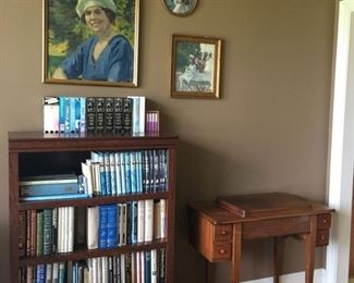 Large Collection of Sherlock Holmes mystery books, nice solid wood bookshelf and antique sewing machine cabinet