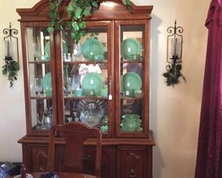 Formal Dinning Roon Set.  China Caminet is full of Jadeite, Crystal Glasses and Silver service set.