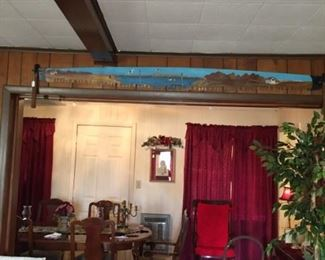 Large painted cross cut saw, pictures, rocking chair, and many artificial trees and plants