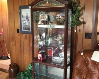 Display Cabinetwith numbered and signed print to the left and chair to the right