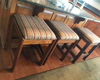 THREE UPHOLSTERED COUNTER STOOLS