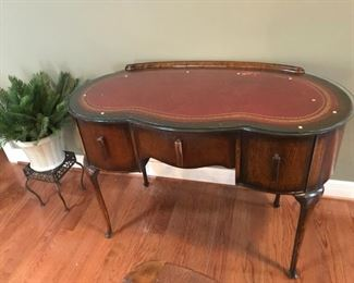 ANTIQUE KIDNEY SHAPED WRITING DESK WITH LEATHER INLAY AND GLASS PROTECTOR TOP