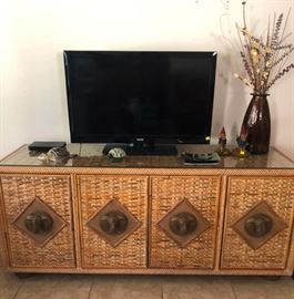 Stunning rattan entertainment console with brass elephant door pulls
