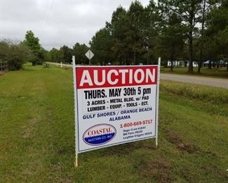 Auction sign posted on Nelson Lane at entrance