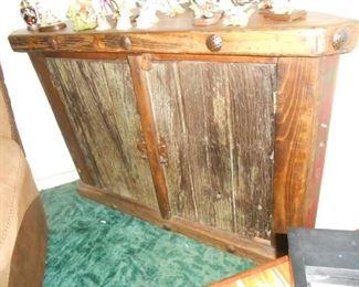 Wood corner cabinet.