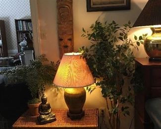 Rattan chest, pottery lamp, wood mask, silk plants