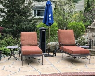 pool side metal chairs and cushions w/round side tables and umbrella